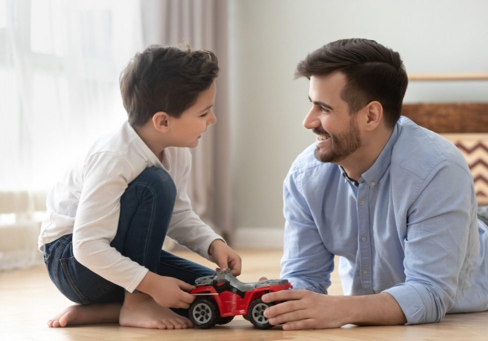 smiling-dad-and-son-playing-racing-cars-at-home-floor-picture-id1159765848 (2)